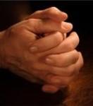 manos en oración
