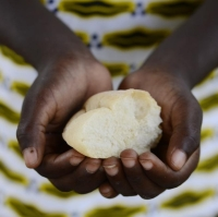 person-holding-bread-representing-malnutrition-and-famine.jpg